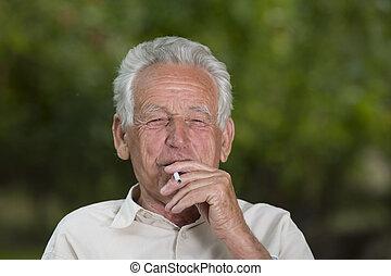 Smoking - Old man smoking cigarette and enjoying life
