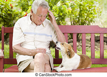 Senior man with his dog - Old man sitting with his dog on...
