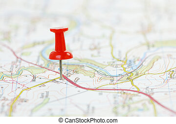 Destination on a Map - Map with red pushpin marking...