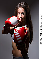 Beautiful girl with the boxing gloves