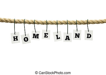 Homeland - Sign Homeland hanging from a frayed rope across a...
