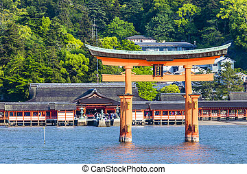 Miyajima, Famous big Shinto torii standing in the ocean in...
