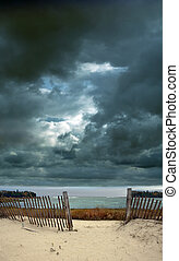 Stormy Sky at the Beach with Fence