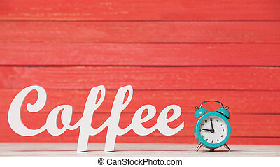 Alarm clock and wooden word Coffee