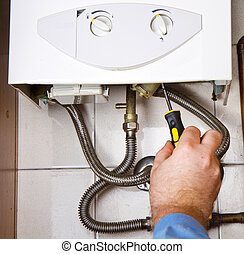 Plumber at work Servicing gas boiler