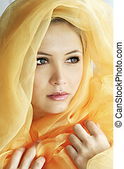 beauty portrait of a young beautiful woman with a shawl