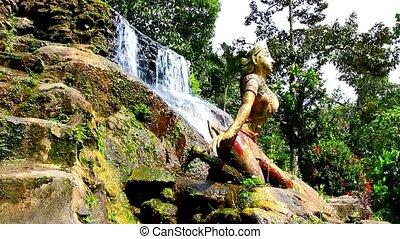 statue of woman on waterfall in the jungle forest. Video