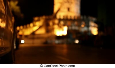 active traffic on the road at night in background of fortress Phra Sumen Fort. Bangkok. Video transition to blur and bokeh