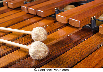 Mallets on marimba - Full frame take of two mallets resting...