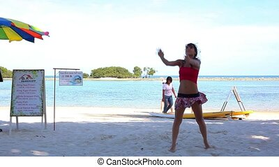 Funny sexy girl playing beach volleyball. Video 1920*1080