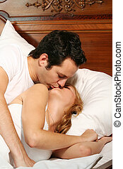 kissing couple - a attractive young couple is kissing in...