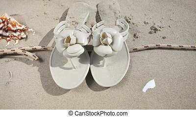 flip flops on beach - Summer vacation. Rope with starfish...
