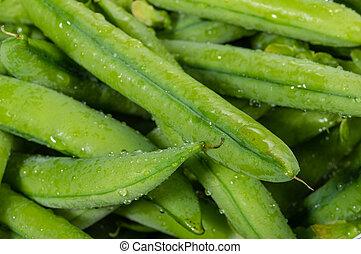 Closeup of fresh picked peas - Fresh picked green peas macro...