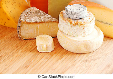 French cheese collection on wooden board with copy space