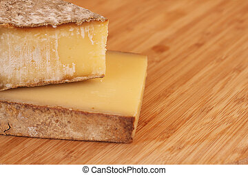 Old french cheese on wooden board with copy space