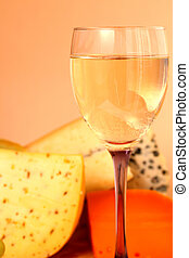 Cheese and wine - Glass of white wine and cheese composition...