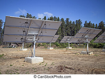 natural energy - solar panels in the forest of northern...