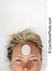 Portrait of a woman at a Spa - Woman at a spa with white...