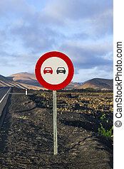 Landscape with a traffic sign: Dont overtake