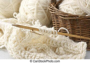 Knitting and yarn - Natural woolen yarn and knitting...