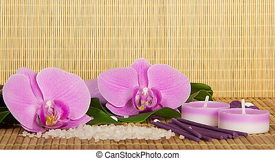 Flowers of an orchid and set for Spa on a bamboo cloth....