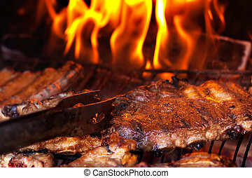 BBQ Ribs - Grilled ribs on barbecue. Family party.