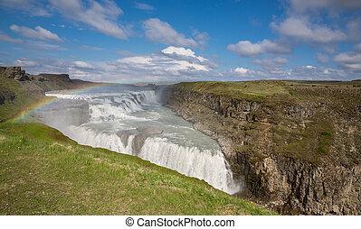 Waterfall Gullfoss and rainbow, Iceland - Panoramic view of...