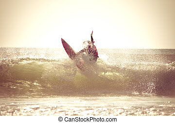 Sunrise Surfing - Surfing in the early morning with retro...