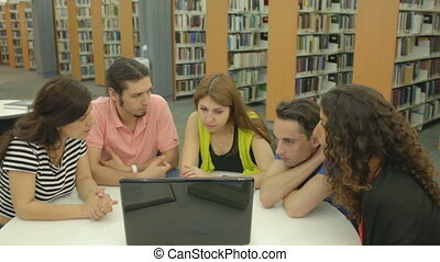 Educational Movie - Five group mates watching training video...