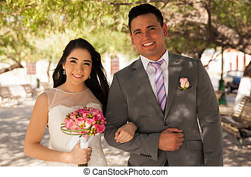 Happy bride and groom - Portrait of a young bride holding...