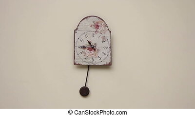 pendulum clock on the wall