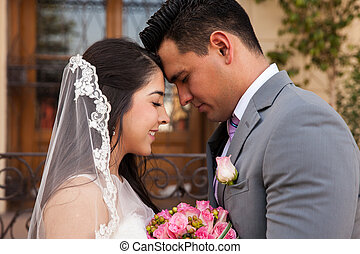 Bride and groom in love - Profile view of a bridal couple...