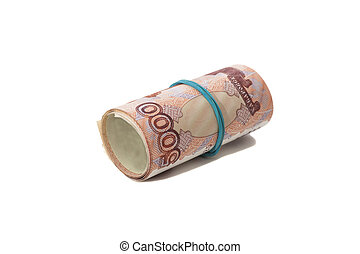 Roll of Russian money with rubber band on white