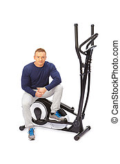 Young man uses elliptical cross trainer