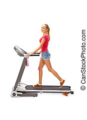 Young woman uses treadmill