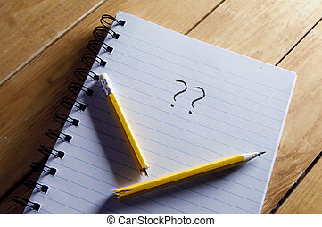 Writers block - Questions mark and broken pencil on top of a...