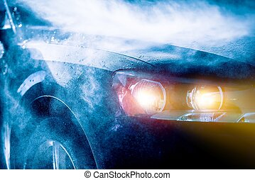 High Rain Car Driving Vehicle Headlights Closeup. Rain...