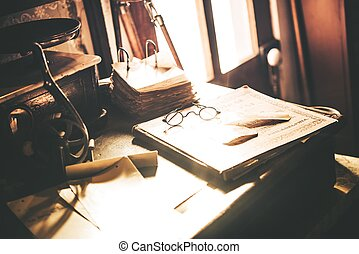 Vintage Desk with Glasses. Aged Wooden Desk, Old Books and...