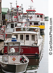 Port Security Fire Boat and Ferry at Dock - Port security...