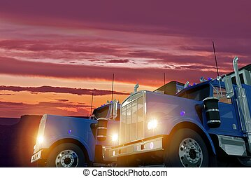 Trucks in Sunset - Two American Large Semi Trucks in Sunset...