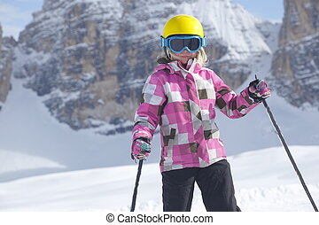 ski sport girl with dolomite rocks in background