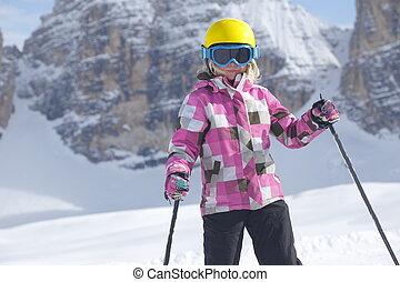 ski sport girl with dolomite rocks in background