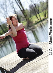 fitness training - young girl is excercising fitness...