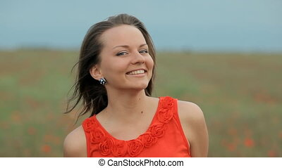 Young smiling beautiful girl in poppy field - Young...