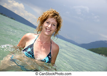young redhead and natural bathing in a lake - young redhead...