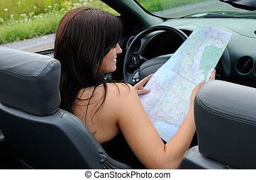Map Reading - Woman Looking For Direction On A Map In Her...