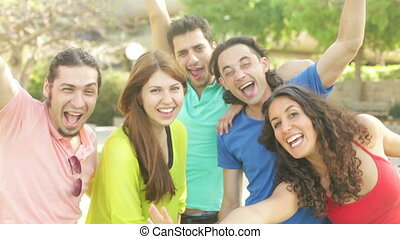 Shareable Selfie - Close up of five jolly friends posing for...