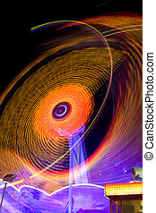 Motion Trail of Ferris Wheel at Night in Carnival