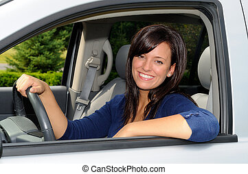 Soccer Mom - Beautiful Young Mother At The Wheel Of Her...