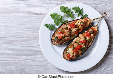 Half baked eggplants with meat, cheese and tomatoes